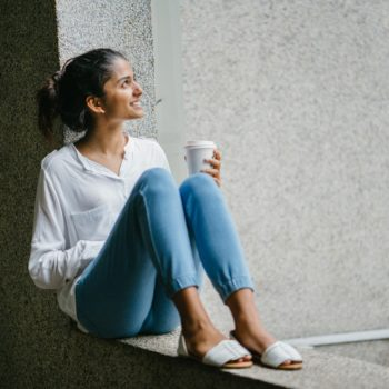 Woman sitting with coffee in hand