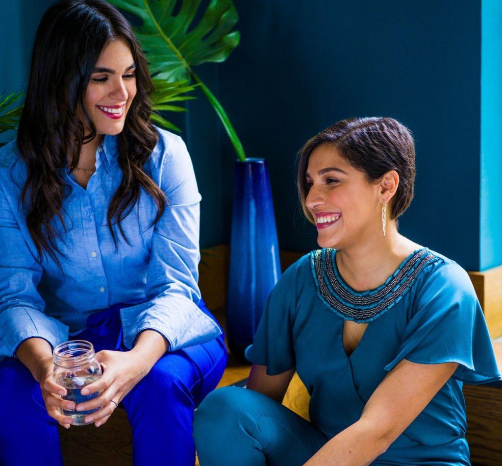 Women in blue talking